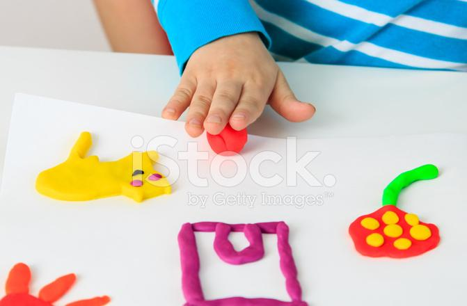 37047500-child-playing-with-clay-molding