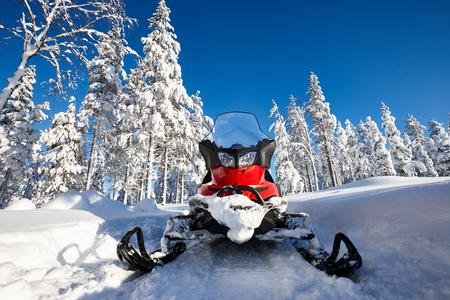 64549121-red-snowmobile-in-finnish-lapla